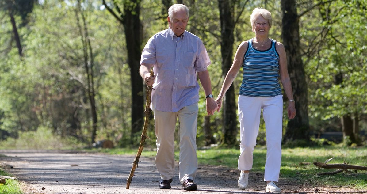 Senior Couple walking through park