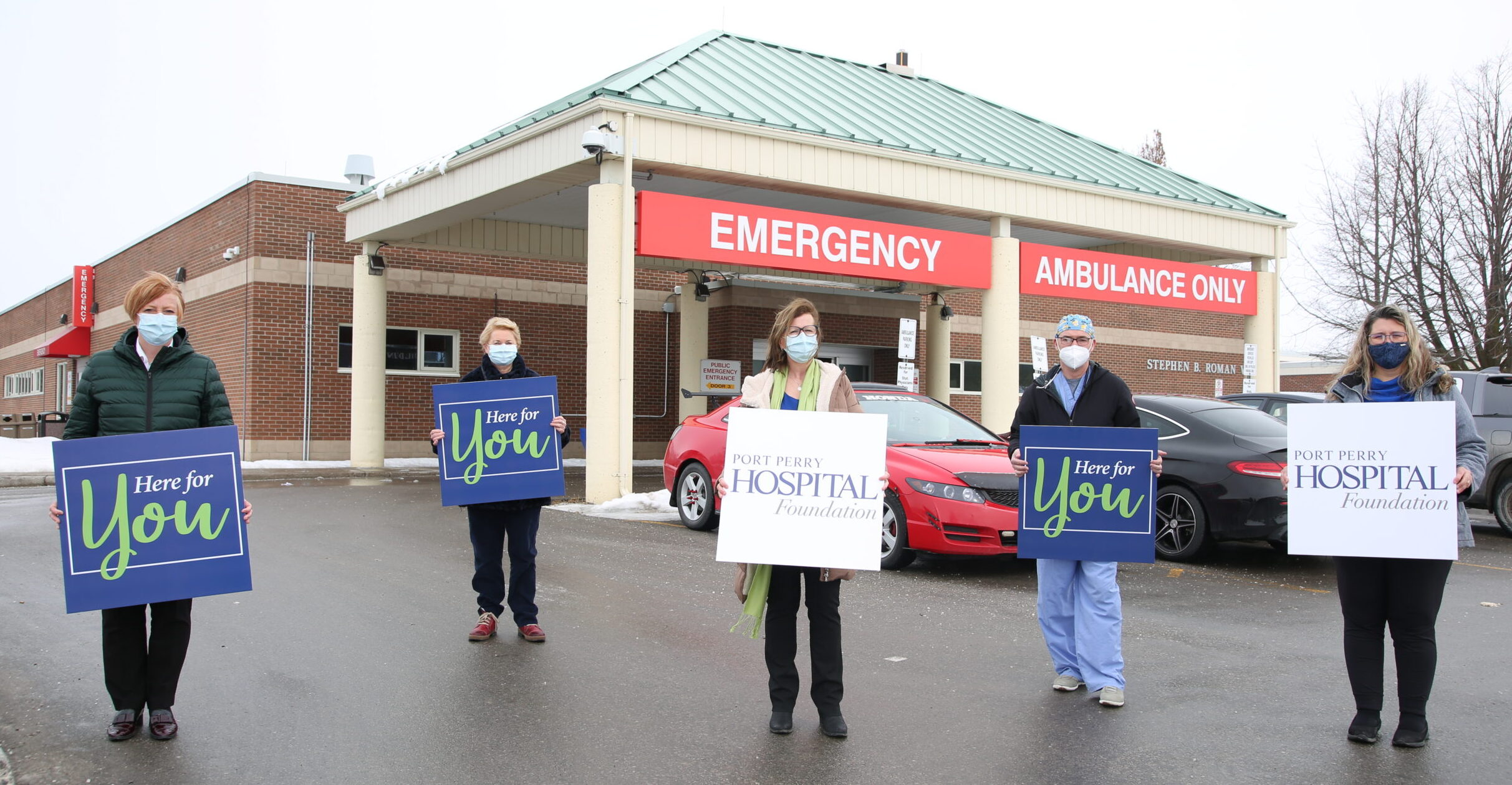 Group holding Here for your Placards, CT scanner Port Perry